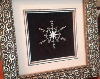 Framed snowflake cross stitch