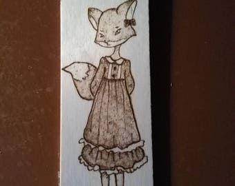 Hand-burned bookmark: fox lady. Pyrography.