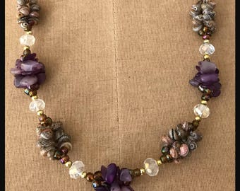 Amethyst chip and seashell necklace.