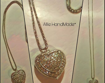 Silver chain necklace and heart pendant with silver rhinestones