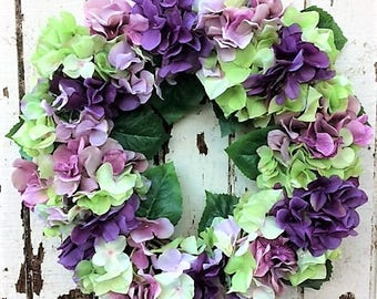 Everyday Hydrangea Wreath where purple is the standout color, It is complimented by Green and Mauve Hydrangeas. Ready to Ship