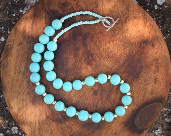 Blue glass bead and silver necklace