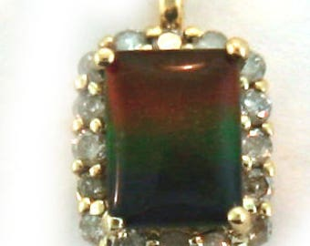 AAA Quality Canadian Ammolite and Diamond Pendant made on 14k Yellow Gold.
