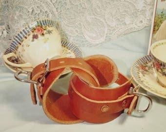 Wrist restraints handmade from saddle-grade leather.