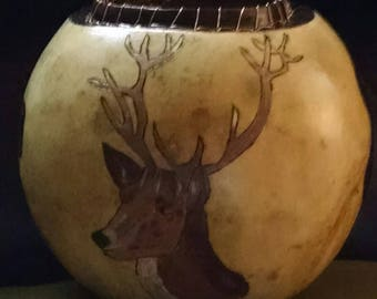 Thick gourd bowl with deer, buffalo and bear.