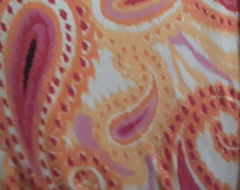 Fabric-poly rayon spandex knit-orange and yellow paisley