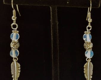 Feather charm earrings with opalescent beads