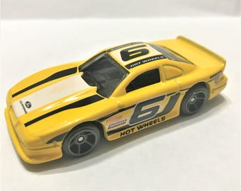 Fridge Magnet:Yellow Ford Mustang Cobra w/#6 Racing Graphic Hot Wheels®