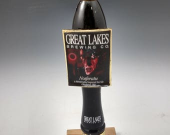 Bar used beer tap made into a hat rack or coat rack.  Great lakes Nosferatu beer,  Cleveland Ohio Made.  Reclaimed