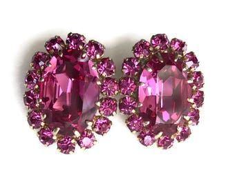 Vintage Austrian crystal earrings.  Fuchsia pink. Rhinestone earrings.Halo style. Clip on