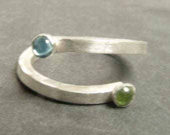 A Love celebration You and Me Sterling silver ring with Blue topaz and Green Peridot