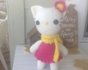 White Kitty with pink dress, yellow scarf