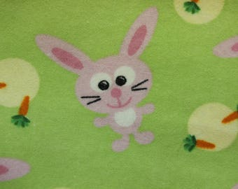"""Bunnies and Carrots on lime green 100% cotton flannel  41""""-44"""" wide"""