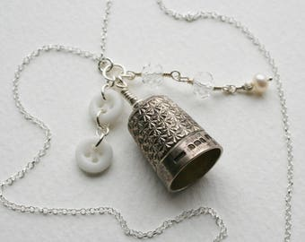 Silver Antique Thimble Charm Necklace 1950s Crystal Bead Pearl Charm and Milk Glass Buttons