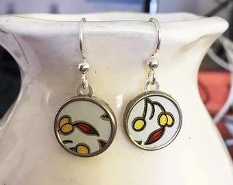 Sweet white with yellow bud earrings made from recycled tins.  Sterling Silver wires.  Super lightweight.