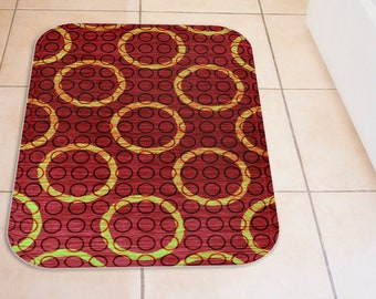 Green and Burgundy Red Plush Bath Mat, Yellow Lime Green Rings Small Black Rings And Dark Red Pattern Bathroom Decor