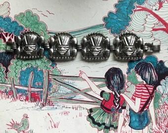 1950's Tiki Head Metal Bracelet