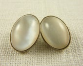 Vintage Pair of Sterling and White Cats Eye Buttons
