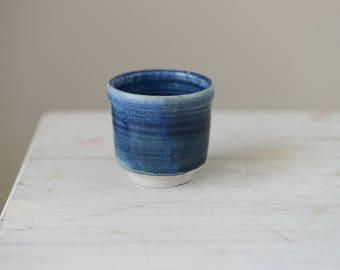 1 Wheel thrown small thick stoneware  cup  with pretty blue glaze holds 75ml