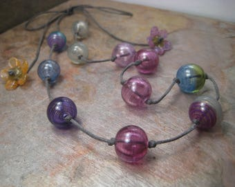 Veiled orphan strand, a glass bead necklace