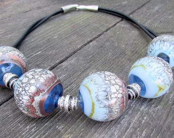 Necklace made of blown beads with interesting decor