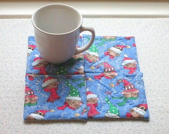 blue christmas cats with a touch of glitter wearing stocking hats hand quilted vintage fabric set of mug rugs coasters