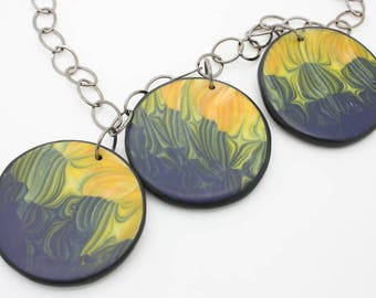 Three large handmade polymer clay discs necklace