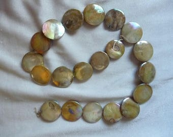 Beads, 16-18mm Flat Round Coin, Mother of Pearl, Shades of Gold, Very Shiny. Sold per 15 inch strand. There are 20 beads on the strand.