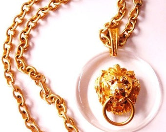 signed Art Lion door knocker necklace    gold tone cast metal clear lucite   signed vintage   ART MODE ModeArt