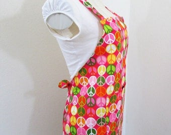 Apron - Bib Apron loaded with Colorful Peace Signs on Hot Pink- A great chefs apron, cooking apron, painting apron....A fun hip print