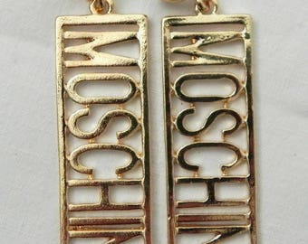 Retro 1990s Moschino letters earrings statement oversized gold jewellery vintage 90s 80s urban fashion blogger belt bag golden large