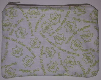 Pouch/coin purse with a zipper and lining. Very cute green owl print.
