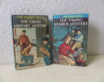Two Hardcover Hardy Boy's Books in good condition.