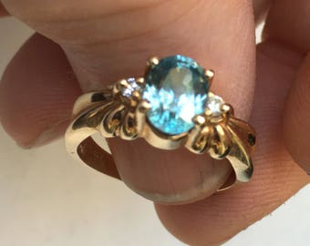 14K yellow gold blue topaz ring with diamonds       VJSE