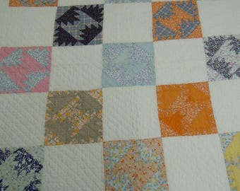 """Vintage quilt: four crowns pattern  hand quilted scrap fabrics from 1940's  with alternating feed sack block 63"""" x 85"""" borders on all sides"""