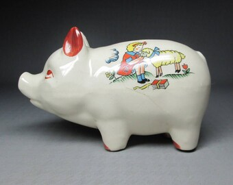 vintage piggy bank , Mary had a little lamb on one side , school house on the other