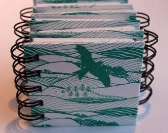 Wire ring bound zigzag note book in Hills and Dales design and box.fun guest book
