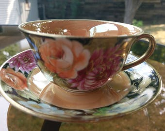 Noritake Floral gold and black teacup and saucer no pattern name.