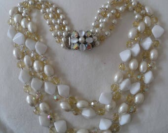 1950's 4 strand glass bead necklace with beautiful clasp.