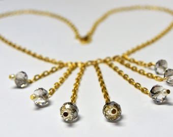 Crystals and gold necklace