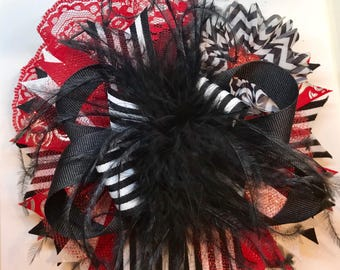 XL 7 inch Valentines bow with Ostrich freathers.
