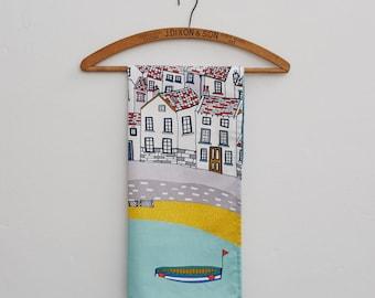 Coastal Village Tea Towel, design led kitchen textiles. 100% cotton tea towel. Designed by Jessica Hogarth and printed in the UK