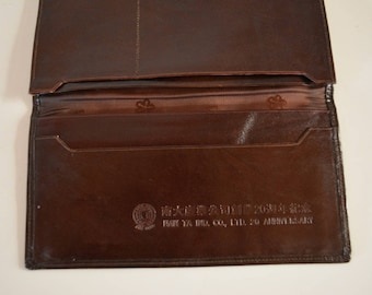 Brown leather wallet, flat purse for notes, bills or documents