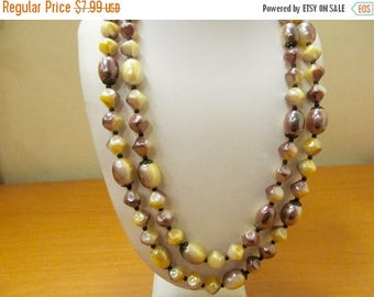 ON SALE Vintage Double Strand Plastic Cream and Plum Colored Beaded Necklace Item K # 3180