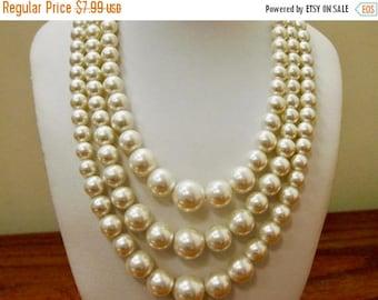ON SALE Vintage Triple Strand Faux Pearl Necklace Item K # 2245