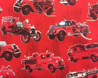 Old Red Firetrucks on red background-antique fire engine