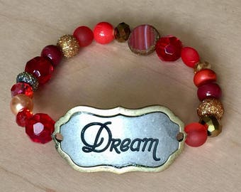 One of a kind, handmade red and gold beaded bracelet with gold/silver DREAM plate