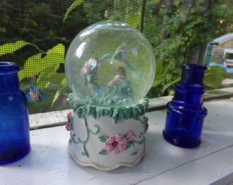Hummingbird Musical Snow Globe . Humming Bird on a Birthday Cake Snow Globe. Vintage Musical Birthday Cake Globe.