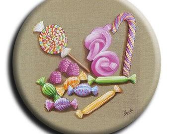 Magnet aimant representant des bonbons, une sucette, deux guimauves et un sucre d'orge sur fond lin en 38 mm