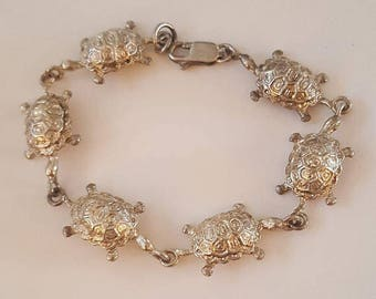 Sterling Sterling Silver Turtles in a Row Link Bracelet